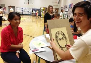 Senior Luke Ferguson draws portrait of Senior Maria Halaguena