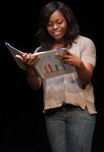 Tiara Brown performs her children's literature piece, The Day the Crayons Quit, which she took to States.