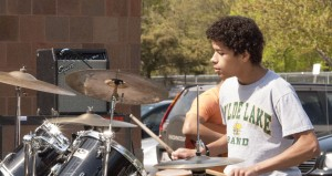 Jordon Moore banging on the drums at the Spring Lunch Jam.