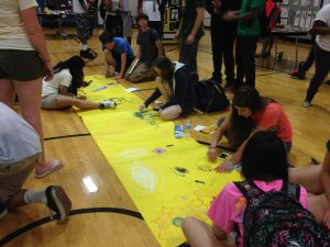 Students gather to draw
