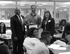 Mr. LeMon and county representatives surprise Mr. Cox with the Crystal Flame Award (Photograph by Natalie Varela).