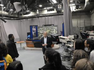 Wilde Lake journalism and yearbook students visited and toured the Philip Merrill College of Journalism at University of Maryland College Park. Dean Rafael Lorente led the tour, and is shown here in Studio A, a multi purpose room, being renovated for use by students.