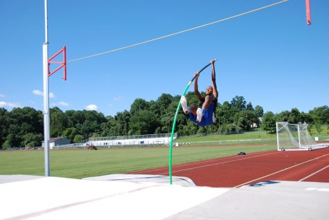 Kareem Press practices pole vaulting.
