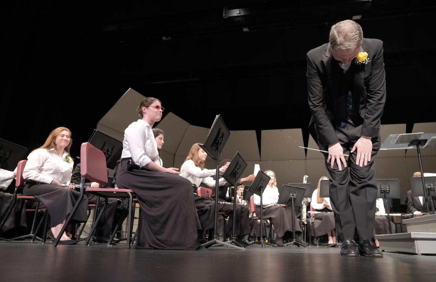 Mr. Dutrow bowing after conducting his last concert.