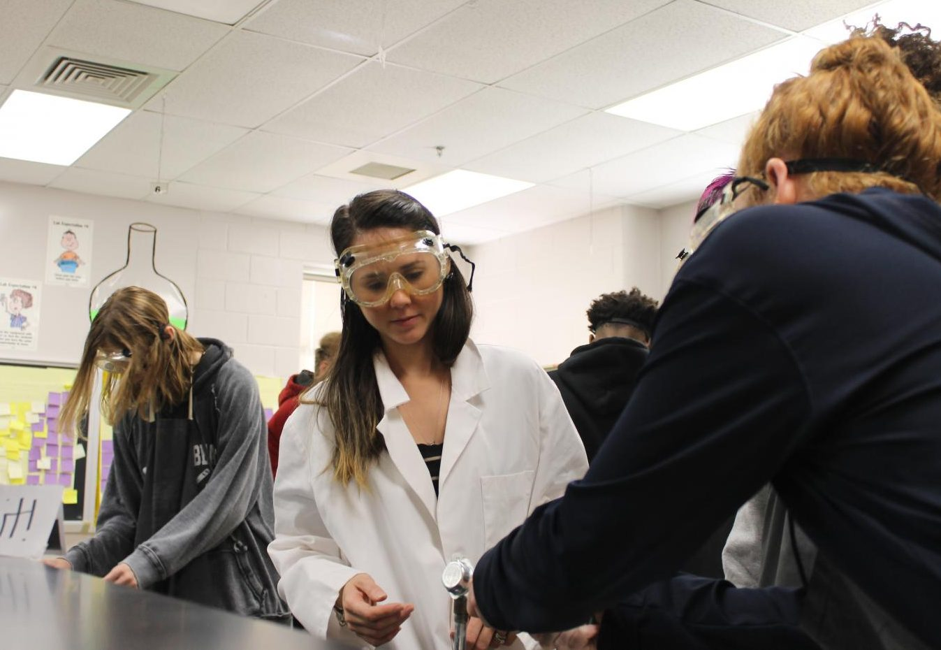 Ms. Alcaraz instructing her students during a science lab.