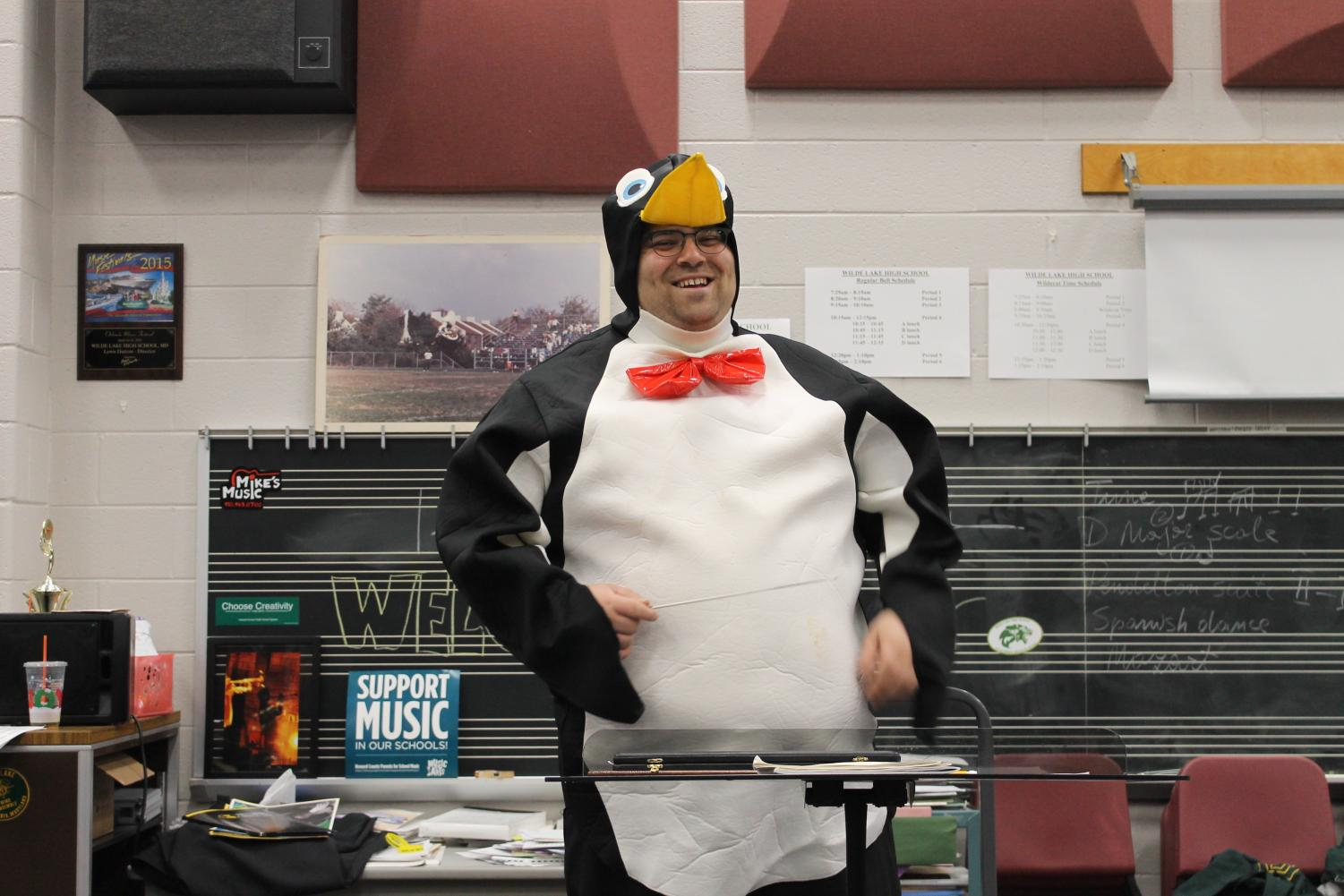 Mr. Green conducting in his penguin costume.