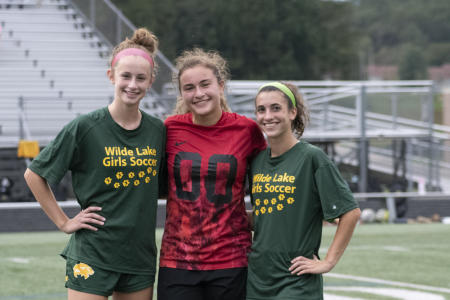 From left to right: Julianna Bonner, Jenna Hutchison and Lily Dunbar pose for a picture.