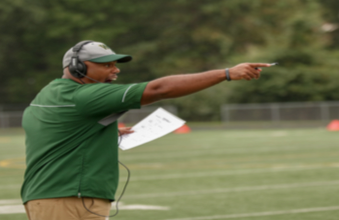 Coach Henderson on the sideline instructing his team