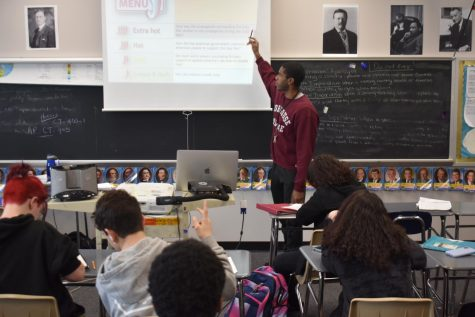 Mr. Press is pictured instructing his U.S History class in his Morehouse sweater that he pridefully showcases.