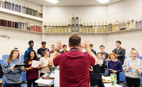 Mr. Crouch, Wilde Lake High School choir teacher, directs his chamber choir class.