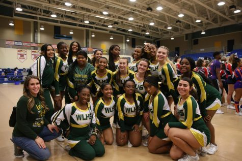 Varsity Cheer Team poses for a picture after regionals.