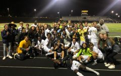 Boys and Girls soccer pose after defeating River Hill in the Regional Championship.