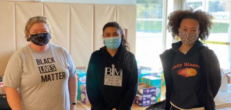 Meg Feroli (left), Erika Chavarria (middle), and Makenna Burns (right) working at one of the Ellicott City donation and distribution sites, December 2020