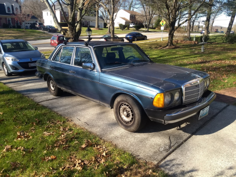 My Mercedes enjoying its favorite pastime: leaking oil all over the driveway