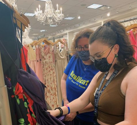 Wilde Lake student Maddy Feldwick and her mother, Rebecca Feldwick, are browsing prom dresses for Maddy's senior prom sponsored by the Wilde Lake Class of 2021 Parent Group.