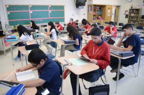 Students in an English classroom. Photo taken by Laura Stoeker, staff photographer for the Daily Herald.